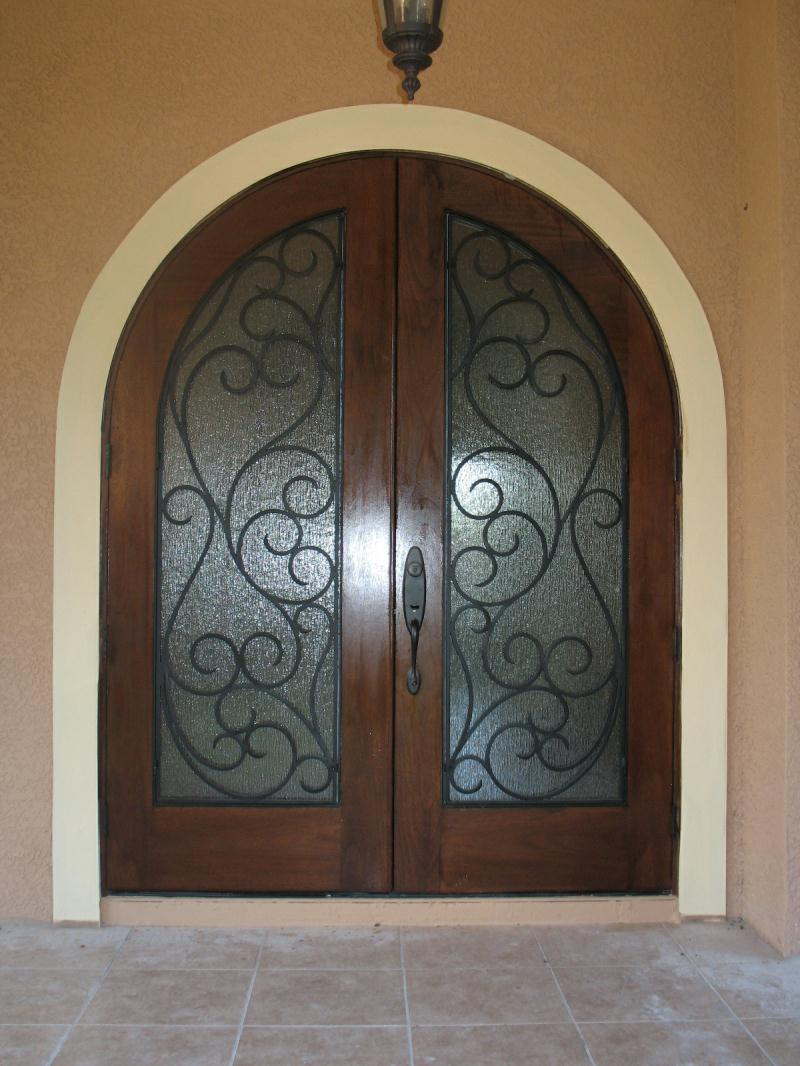 Welcome to gallery browse thru our for Wood doors with wrought iron